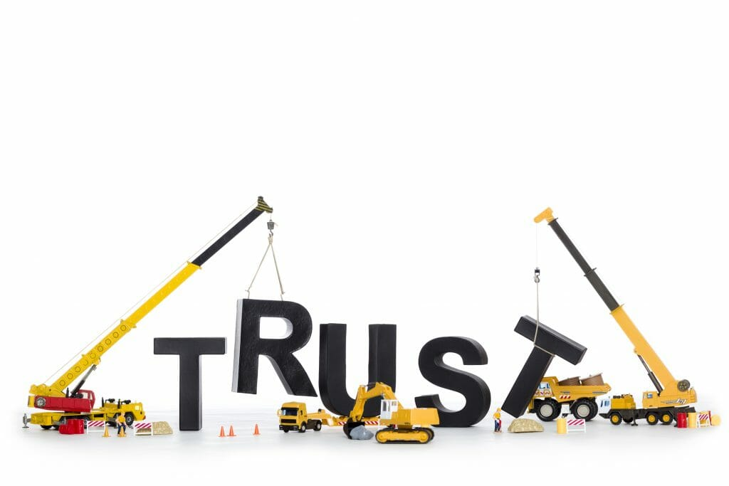 A team of professionals build the word trust